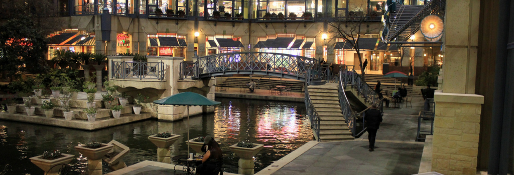 mall  terrace with water and people walking